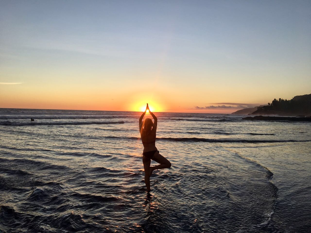 yoga pose in front of the ocean
