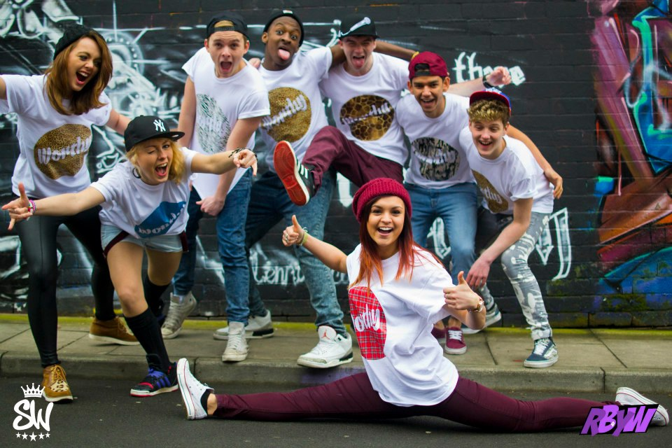group of multicultural dancers posing