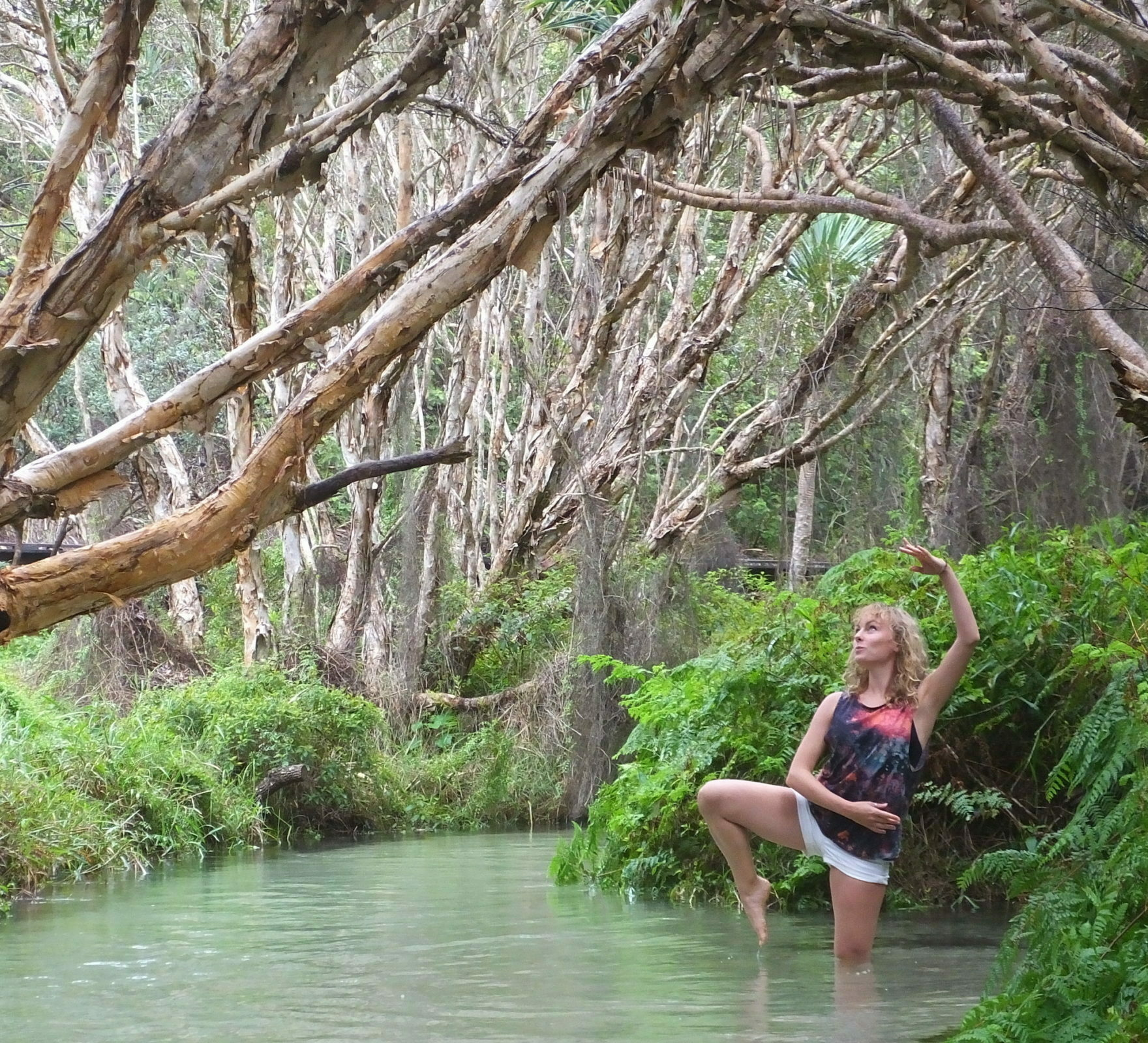 ballerina standing in a river in the jungle