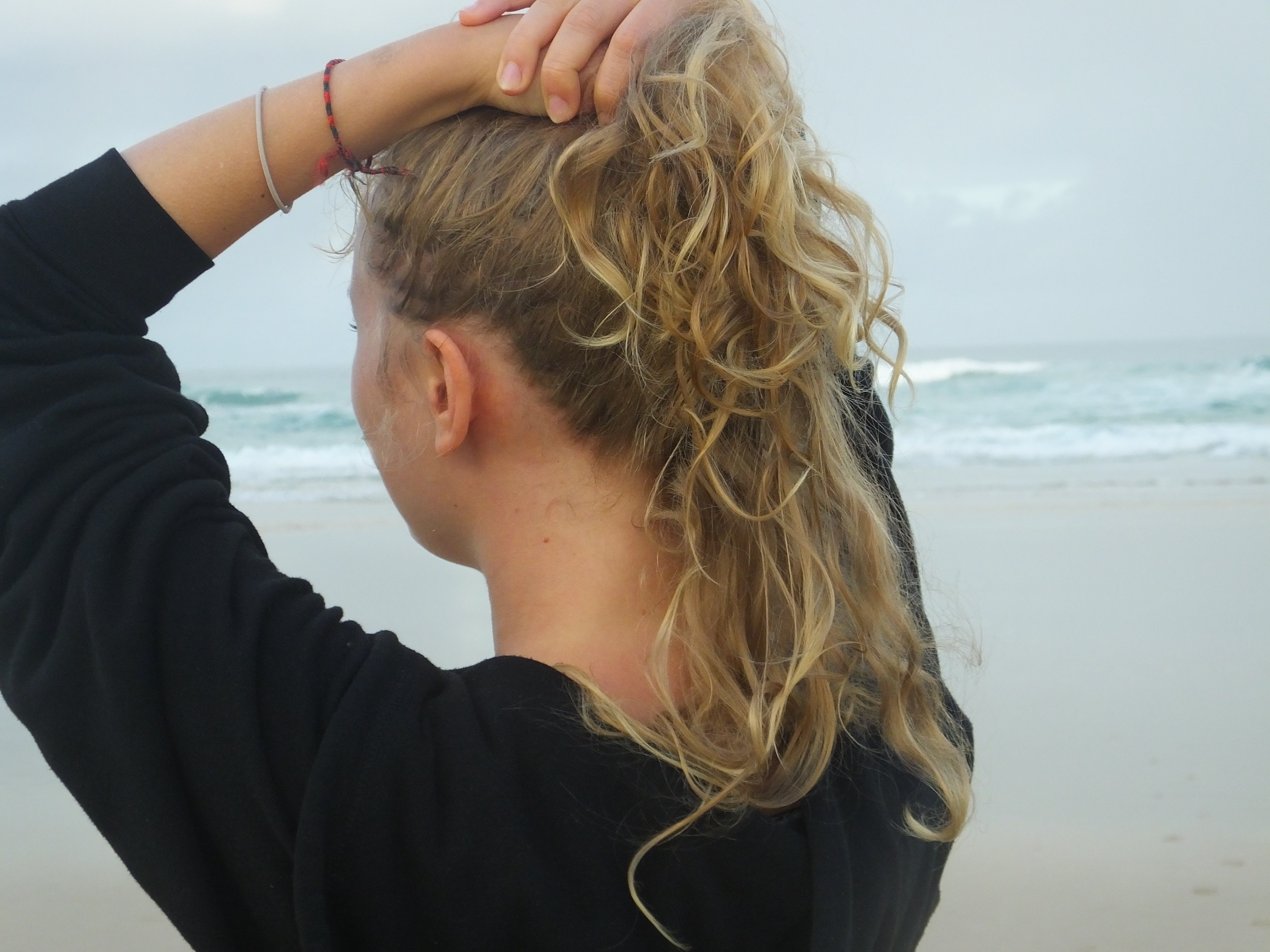 woman holding her hair up