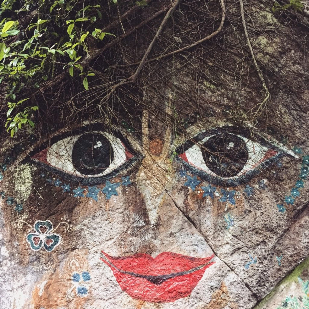 stone wall painting of a face