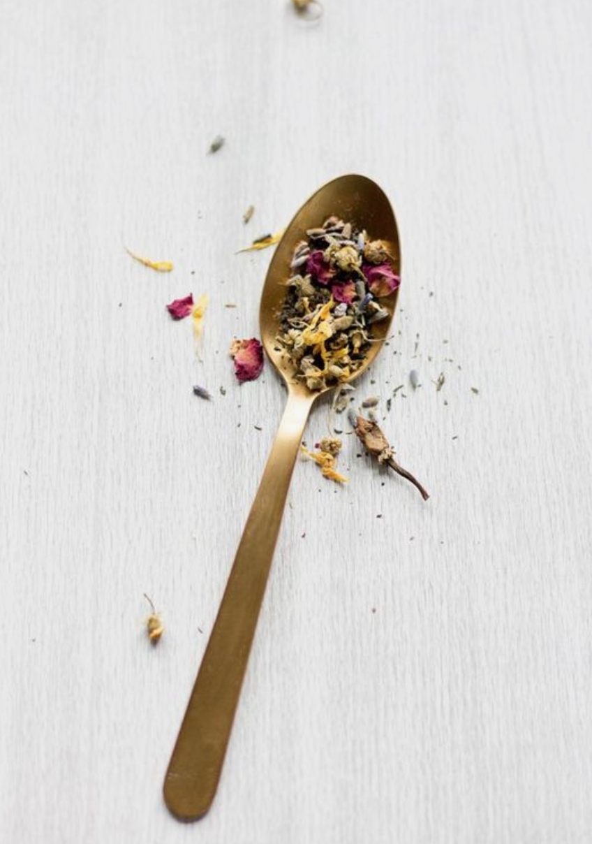 spoon with medicinal herbs