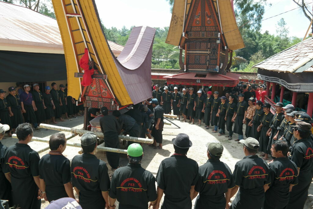 death ceremony of toraja - men in black standing in a circle
