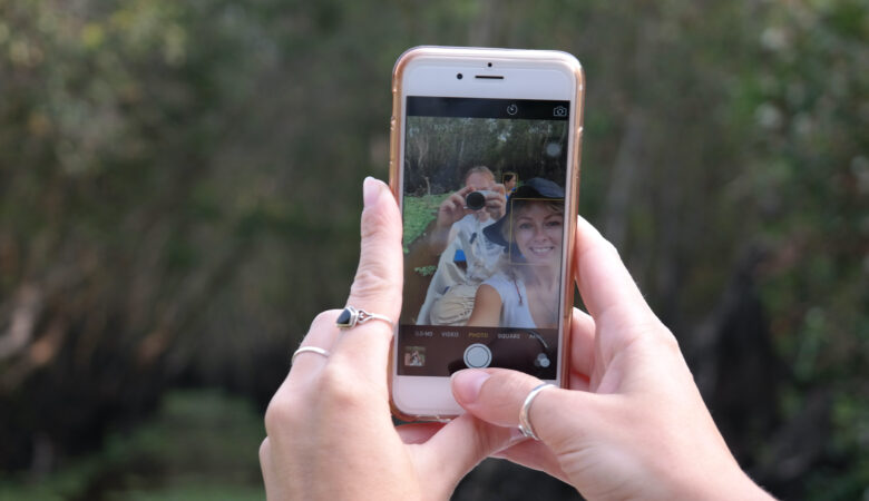 woman holding smartphone taking a picture