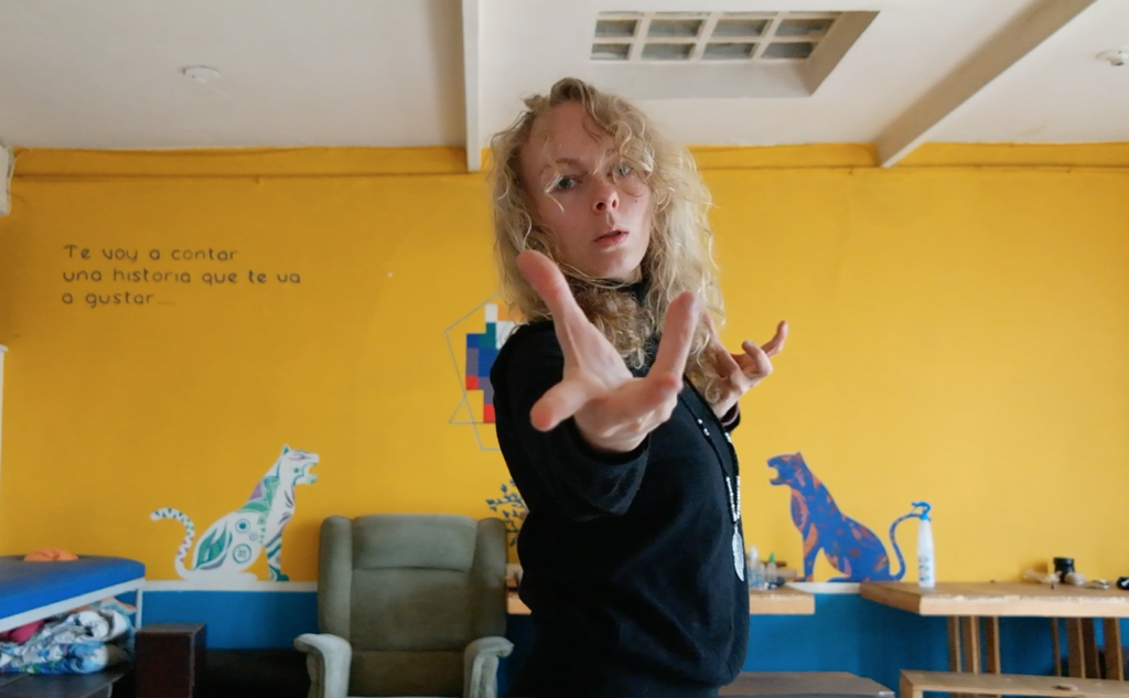 blond woman stretching out her hand
